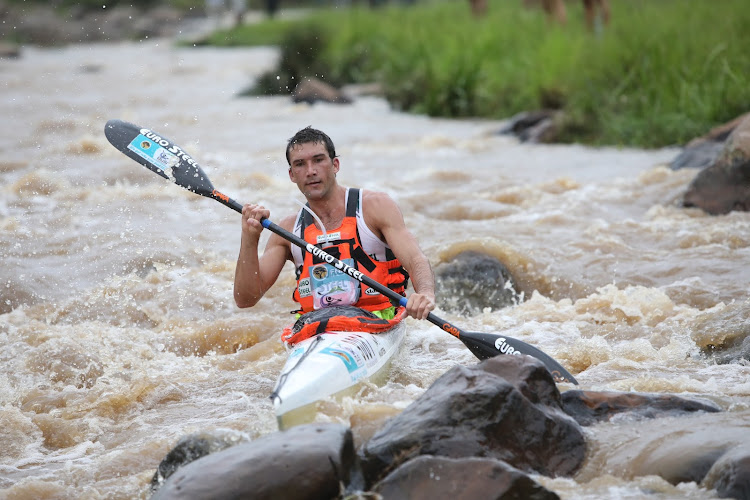 Andy Birkett battles over the rocks at Mission Rapids on Day 1 of the Dusi Canoe Marathon. He came in second behind Sbonelo Khwela.