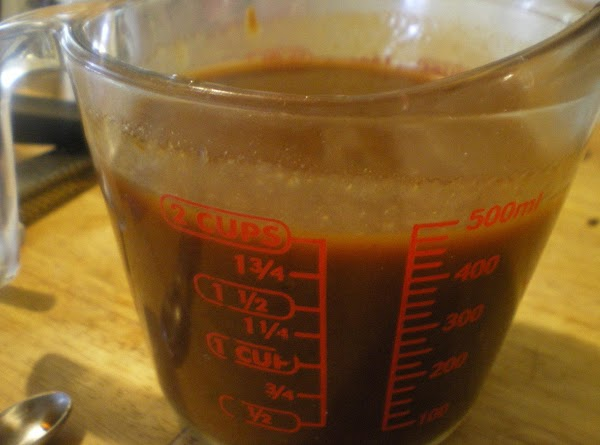 In a 2 cup measuring cup add bbq sauce, mustard, liquid smoke, and wing...