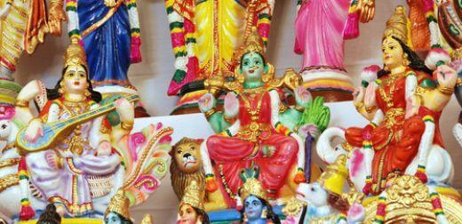 Dolls of Durga (middle) Lakshmi (right) and Saraswati (left)