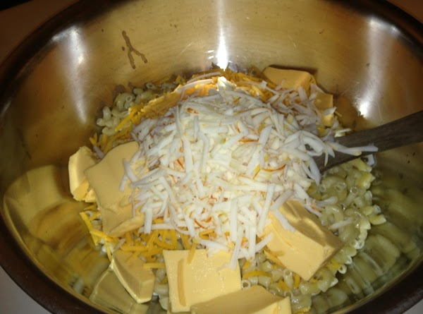 Spoon pasta and butter into a large mixing bowl then add all the cheeses...