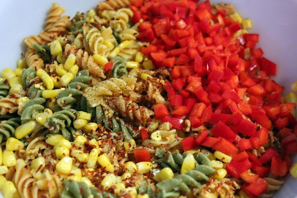 Drain and rinse pasta/corn with cold water. Transfer to bowl. Add diced red peppers,...