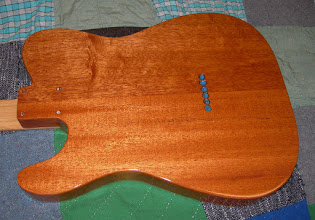 Photo: Musikraft 2-piece mahogany thinline body.