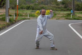 Photo: May 7, 2011. Odaka, Fukushima, Japan. While tracking a dog inside the evacuation zone, about 15.6km from the Daiichi reactor, a strange man appeared out of no where.