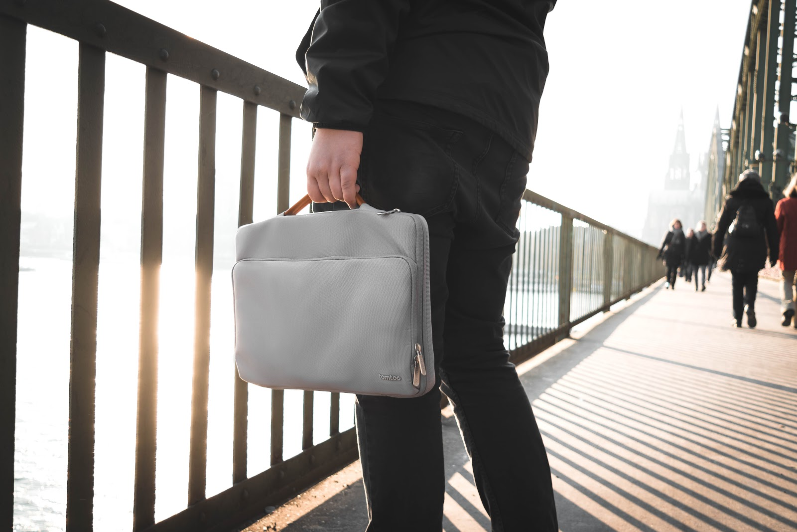 Person holding a briefcase.