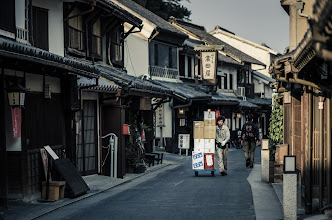 Photo: Evening Delivery  I love the feel of the Bikan Quarter in Kurashiki City. Aside from the lovely architecture from hundreds of years ago, they even made sure to avoid above ground power lines in order to preserve that atmosphere. And although this is a modern delivery man with a modern company, being as it is a merchant's district, I suppose delivery service is something the area is quite accustomed to.  More at the blog: http://lestaylorphoto.com/kurashiki-bikan-historical-district/  #travel #japan