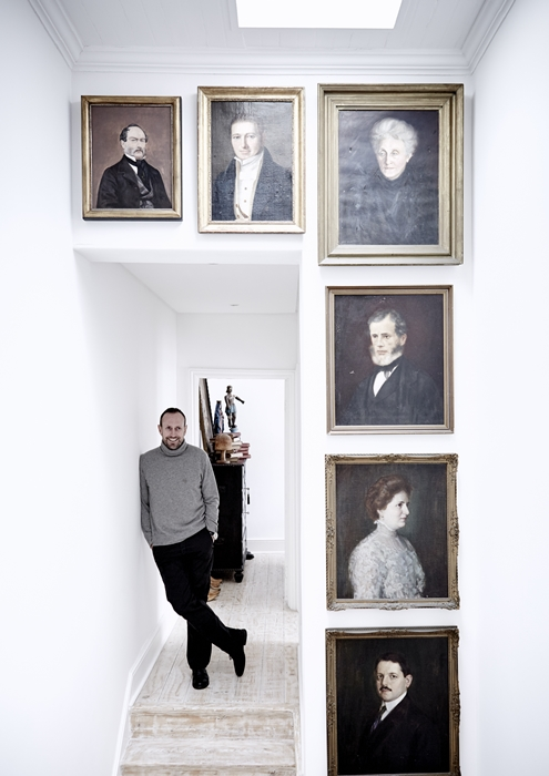 "Otto de Jager with his ""gallery of instant ancestors"" on the staircase landing."