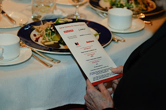 Photo: A guest reviews the evening's sponsors on the back of the program.