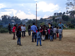 Photo: More IGo student ministry with the children at Tening town.