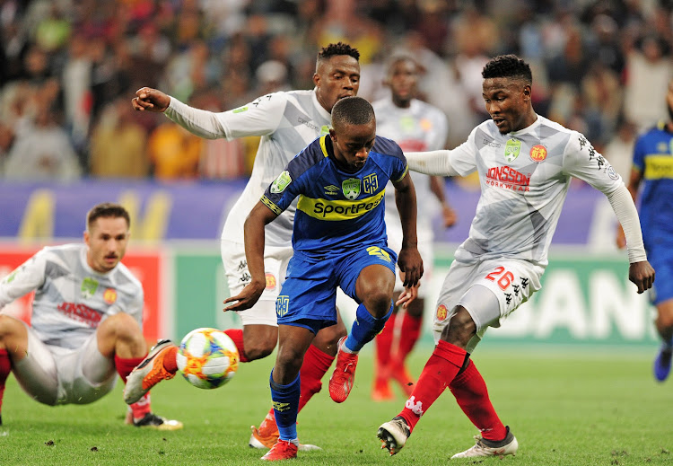 Thabo Nodada of Cape Town City is tackled by Phoka Mofokeng of Highlands Park during the 2019 Nedbank Cup last 16 game between Cape Town City and Highlands Park at Cape Town Stadium on 15 February 2019.