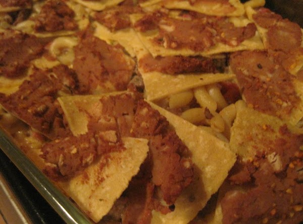 While the casserole is baking prepare your toppings. Serve as you would nachos. Dig...