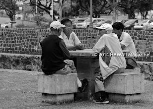 Photo: CULTURE CATEGORY, FINALIST. Four men talking story near River Street in Honolulu's Chinatown district. Photo by Kim Reese, Hershey, Pennsylvania.