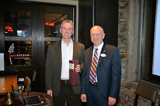 Photo: ASHRAE OVC President Rod Potter presenting thank you gift to Dr. Guy Newsham