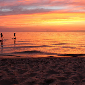 Paddleboarders in Afterglow by Jennifer Smusz - Landscapes Sunsets & Sunrises ( #puremichigan, #sunset, #afterglow, #paddleboarders, #lake, #beach )