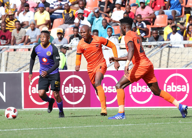 Hendrick Ekstein of Kaizer Chiefs challenged by Bongile Booi and Salulani Phiri of Polokwane City during the Absa Premiership 2018/19 match between Polokwane City and Kaizer Chiefs at Peter Mokaba Stadium, Polokwane on 23 February 2019.