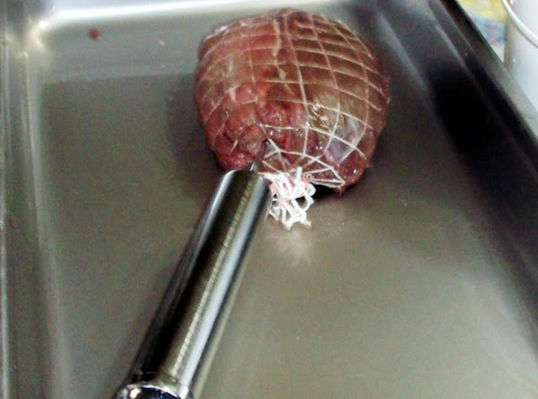 Injecting the meat.
