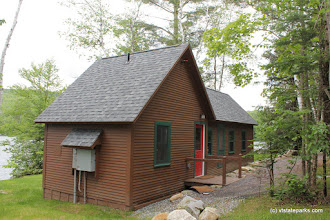 Photo: Exterior of Perry Merrill cottage at Ricker Pond State Park