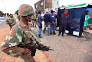 Soldiers supporting the police in Lavender Hill on the Cape Flats in August 2011. Now soldiers with peacekeeping experience in the Sudan and DRC have been deployed. File photo.
