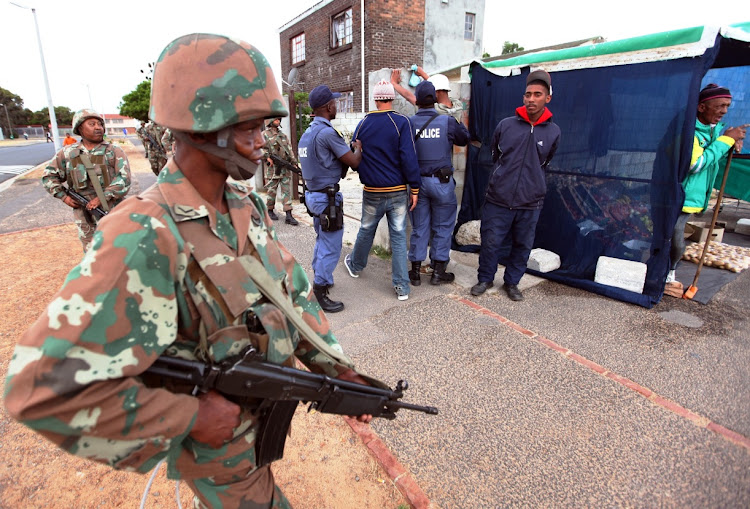 Soldiers assist the police in the gang-ridden Cape Flats suburb of Lavender Hill in August 2011. Now soldiers have been ordered back on to the streets.