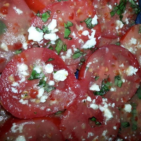 For each layer of the sliced tomatoes: Put sliced tomatoes on platter, add mozzarella, add basil. Drizzle with...