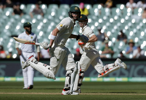 Australia v South Africa - Third Test cricket match - Adelaide Oval, Adelaide, Australia - 27/11/16. Australian batsman David Warner (R) and Matthew Renshaw run down the pitch during the fourth day of the Third Test cricket match in Adelaide. REUTERS/Jason Reed