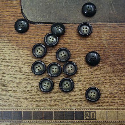 Skjortknapp 15mm - svartspräcklig