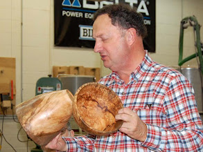 Photo: Stan Wellborn shows his simply shaped bowls that show off the very figured maple burl wood.