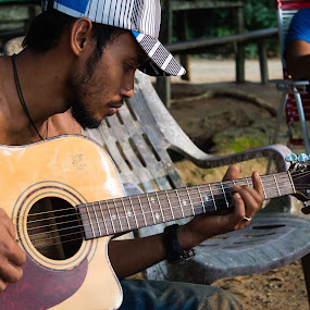 In the Jungle by Hadrien Léger - People Musicians & Entertainers ( guitar musician jaming taman negara jungle malaysia )
