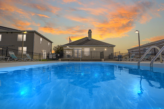 Refreshing swimming pool with lounge chairs at dusk