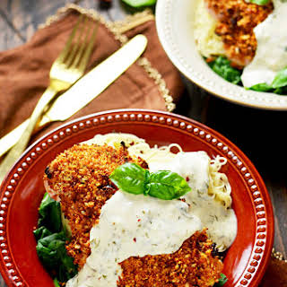 Sun-Dried Tomato Crusted Chicken with Goat Cheese and Herb Sauce.
