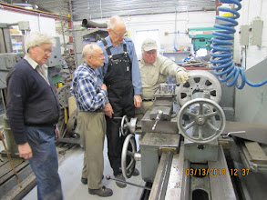 Photo: The lathe crew, L-R, Ross, Allan, Ed. Sr, and a new DHC member, inspect the fruits of their labour.  Photo courtesy of Jack Loucks.