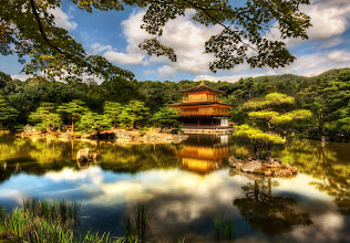 Photo: The Golden Pavilion  This is one of the most famous temples in Kyoto, so of course I had to go.  It's sort of like going to the Eiffel Tower in Paris or Rudy's BBQ in Austin.  It was originally built back in 1397 and has been destroyed and rebuilt several times.  The building itself is as meticulous as the gardens around it.  The Japanese really know how to tend a garden!    There was a fleet of workers all over the grounds, sweeping up and rearranging little bits here and there.  It was all very quaint and wonderful.  from the blog at www.stuckincustoms.com