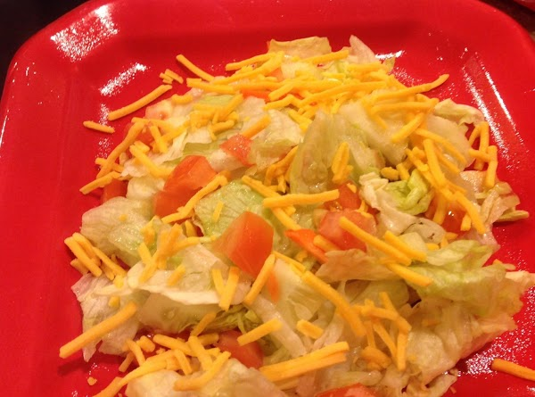 Top with shredded cheese.