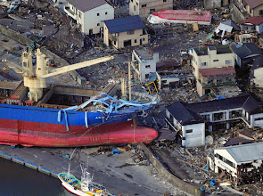Photo: A ship is swept by waves after a tsunami and earthquake in Kamaishi City in Iwate Prefecture March 12, 2011. Japan confronted devastation along its northeastern coast on Saturday, with fires raging and parts of some cities under water after a massive earthquake and tsunami that likely killed at least 1,000 people.  REUTERS/YOMIURI (JAPAN - Tags: DISASTER) FOR EDITORIAL USE ONLY. NOT FOR SALE FOR MARKETING OR ADVERTISING CAMPAIGNS. JAPAN OUT. NO COMMERCIAL OR EDITORIAL SALES IN JAPAN