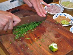 Photo: mincing kaffir lime leaves