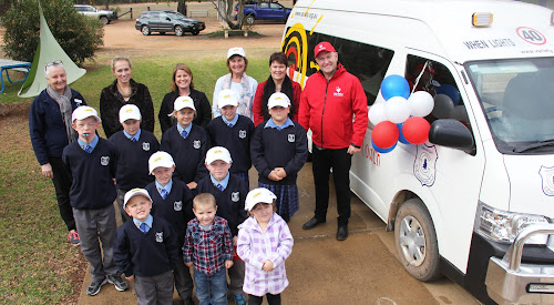 Enjoying the new Gwabegar Public School bus are, back, school learning support officers Theresa Draper and Hallie Knight, relieving principal Katie Sullivan, teacher Sonia Miller, substantive principal Helen Gray and Variety Club regional director Jason Bourke, third row, students Jack Thompson, Aidan O'Grady, Sophie Andrews, school captain Tayla Dunn and  Caitlyn Bingham, second row, Logan O'Grady and John Ward, front, Charlie Ward and pre-schoolers Oliver Ward and Paige O'Grady.