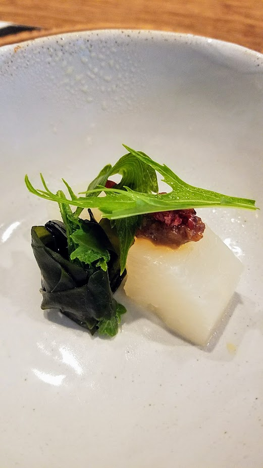 Nodoguro Twin Peaks themed dinner dish of Funeral Waldorf, Daikon soaked in rice water toped with aged miso, walnuts toasted in walnut oil, cherries, mizuno lovage, and wakame