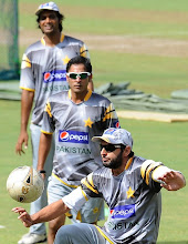 Photo: Pakistan cricketer Shahid Afridi (R) plays football with teammates during a practice session at the R. Premadasa Stadium in Colombo on June 15, 2012.  The remaining two matches in the one-day series between Sri Lanka and Pakistan will have reserve days due to rains in the country, Sri Lanka Cricket (SLC) announced. The last two day-night games of the five-match series are scheduled to be played in Colombo on June 16 and 18 with rain forecast for both days.   AFP PHOTO/ LAKRUWAN WANNIARACHCHI        (Photo credit should read LAKRUWAN WANNIARACHCHI/AFP/GettyImages)