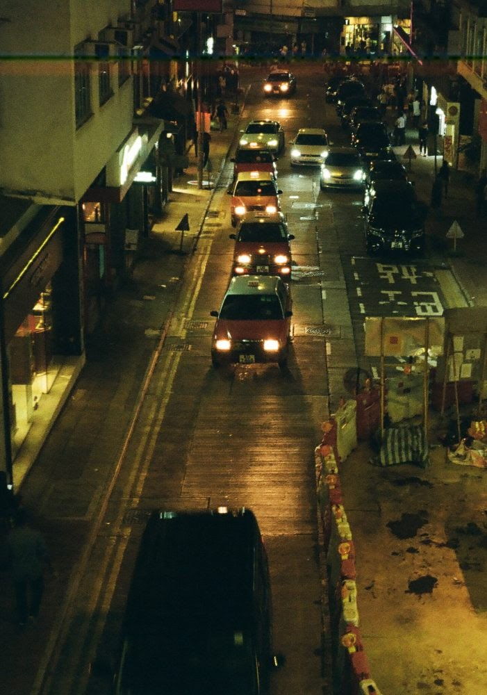 Red taxis at night