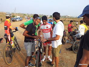 Photo: NJ loaning his Garmin on the bike! I for one think all the numbers are pretty useless for Kiran. I doubt he would look at any at all!