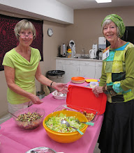 Photo: Grannies Marilyn and Barb arrange food for the potluck.