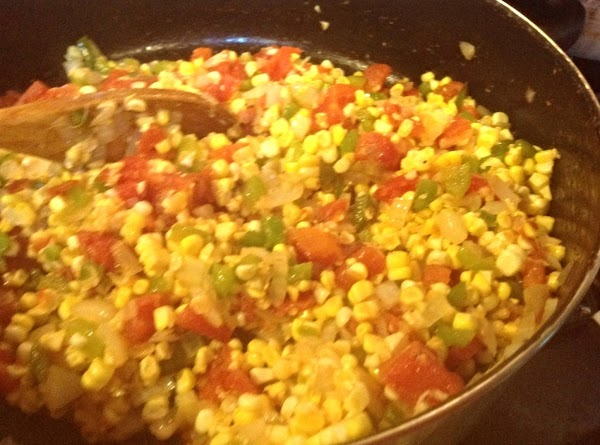 Add the corn and continue to cook over medium high heat, stirring frequently to...