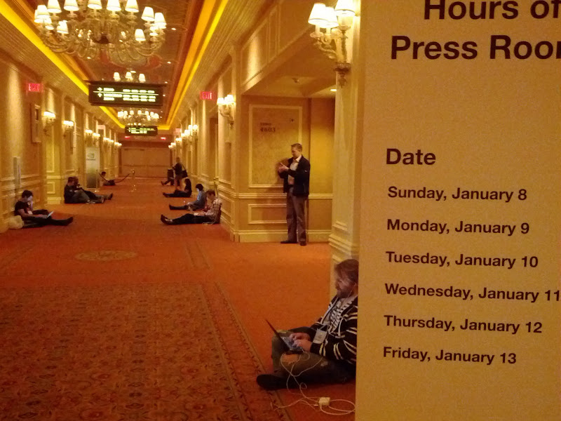 Photo: Journalists camped out in the hallway outside the press room.