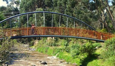 Photo: Sheila waving from bridge over Ambato River