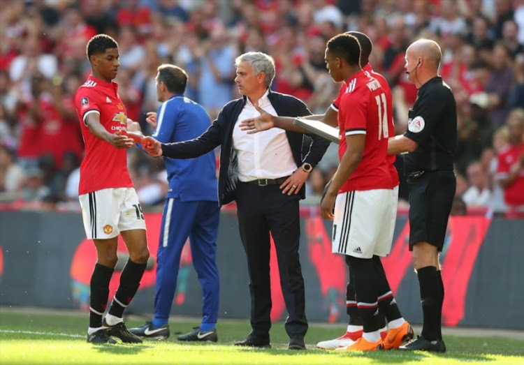 Marcus Rashford of Manchester United shakes hands with Jose Mourinho the head coach / manager of Manchester United during The Emirates FA Cup Final between Chelsea and Manchester United at Wembley Stadium on May 19, 2018 in London, England.