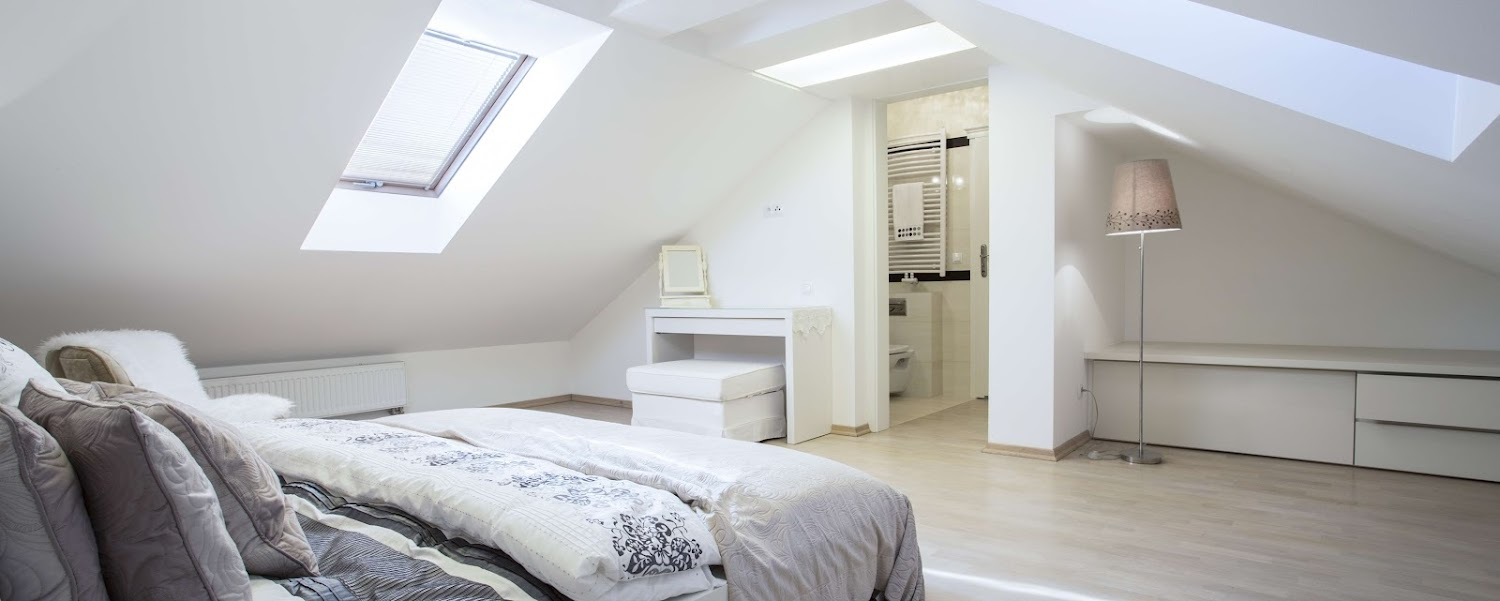A modern designed bedroom in a converted loft