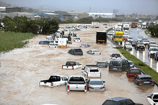Emergency: KwaZulu-Natal was declared a disaster area after storm damage, such as this flooding in Prospecton Road, south of Durban, hit the province. Picture: THE TIMES