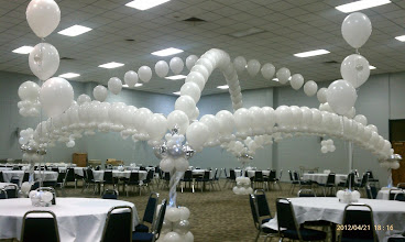 "Photo: criss-cross and all around string of pearls arch  with lights for ""all white party"""