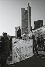 """Photo: Occupy Frankfurt – It says (excuse my poor english, please): """"Those who build high, can fall deep"""" The buildings in the background are bank buildings."""