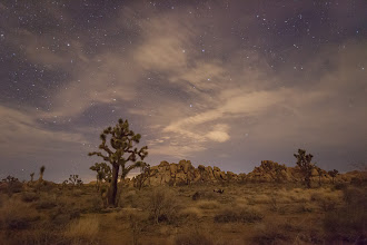 Photo: Joshua Tree National Park is a great place to visit but at night the surrounding cities flood the skies with light pollution.  If I remember correctly, the white clouds in the cetner are lit up by the town of Twentynine Palms.