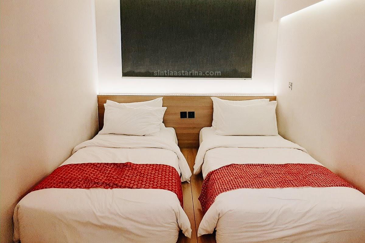 Tempat tidur yang nyaman di Qubika Hotel Serpong